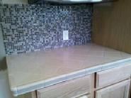 1/2 inch glass tile splash with 6 inch porceilain countertop