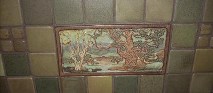 Custom hand made tiles set into fireplace