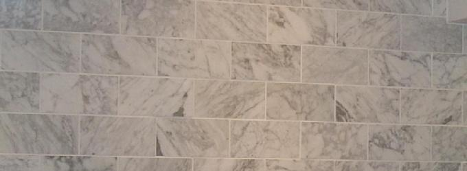 Marble tiles set in running bond pattern